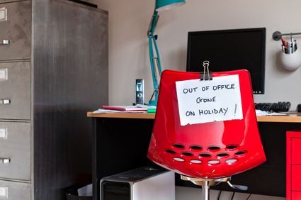 Employee leaves note on back of office chair: Out of Office. Gone on Holiday!